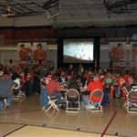 Crowd and TV screen at Blackhawks Roadwatch Party at Libertyville Sports Complex April 9 2013