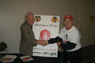 Bobby Hull and Connie Kowal THANK YOU BOBBY Sign at Blackhawks Roadwatch Party at LSC April 1 2016.jpg